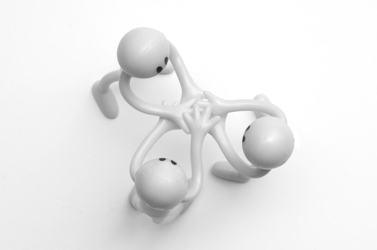 3 men figures business partnership teamwork for engineering and LCD design