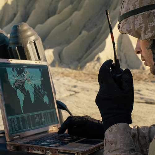 Soldier using a rugged LCD display in computer laptop
